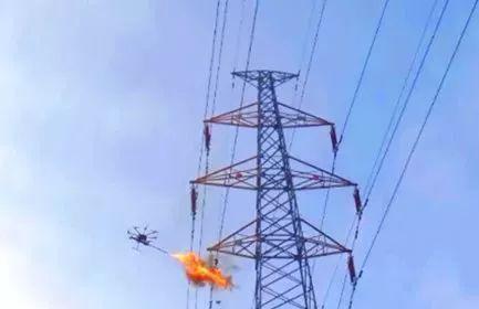 利用六旋翼无人机携带喷火装置,采用燃烧的方法清除异物